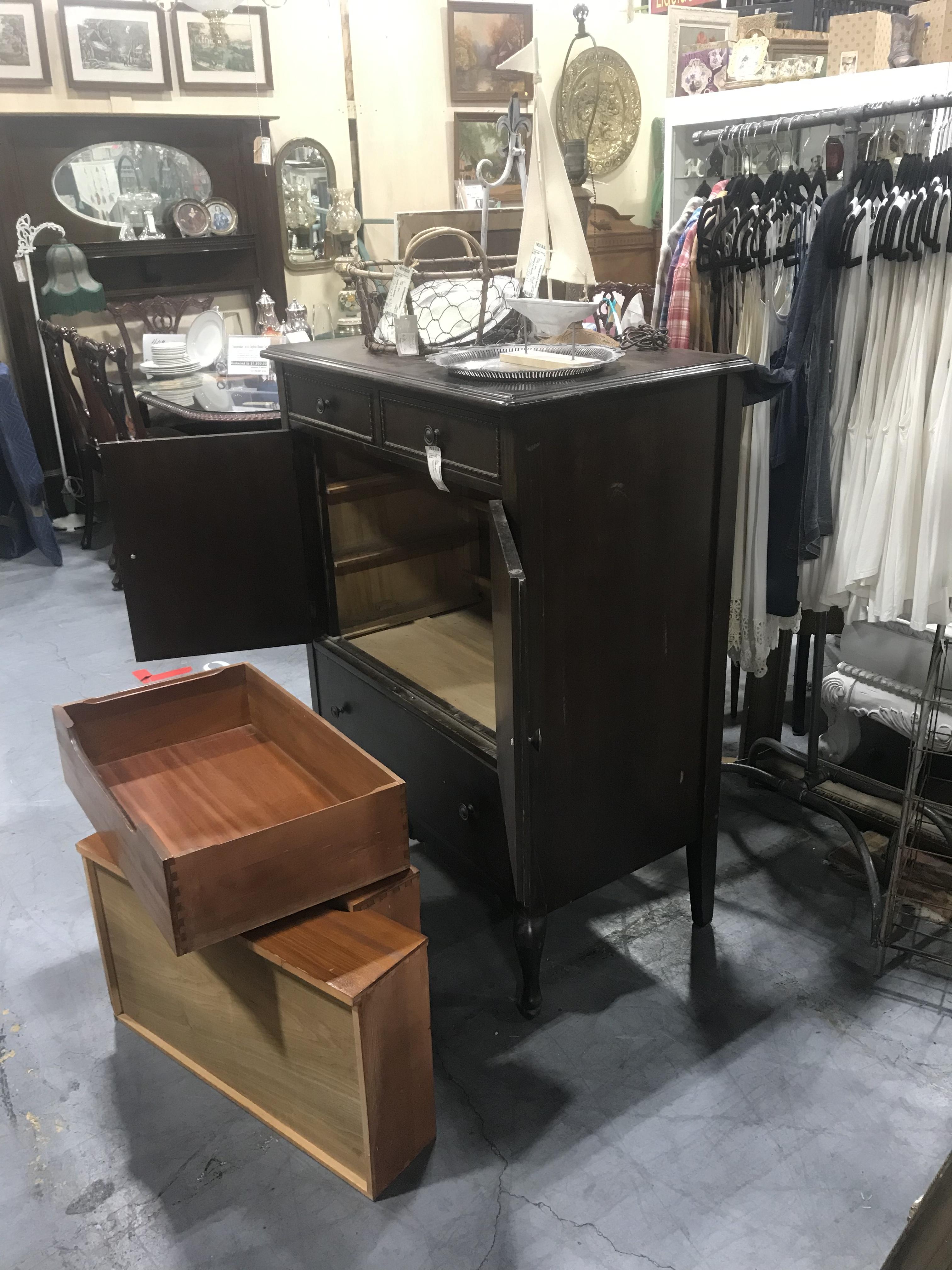 Brown wardrobe cabinet with open doors