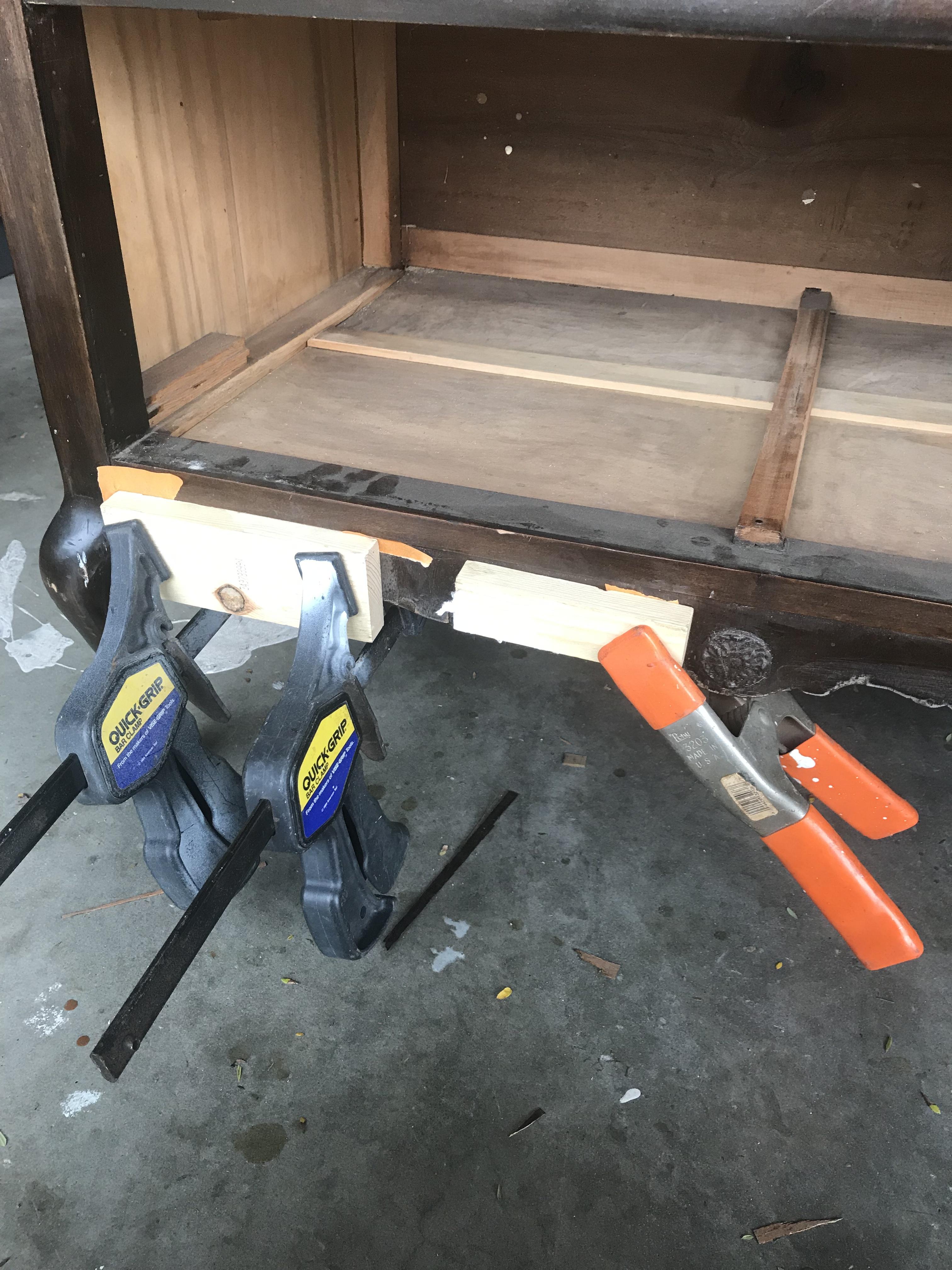 Clamps holding down wood veneer.